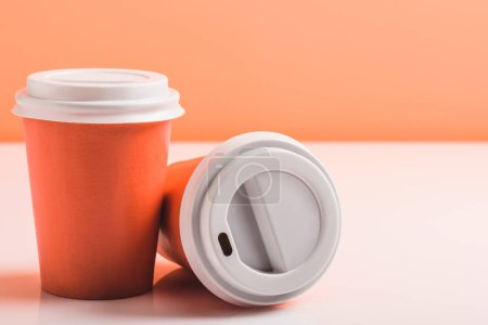Photo for Color disposable cups on white surface, color of 2019 concept - Royalty Free Image