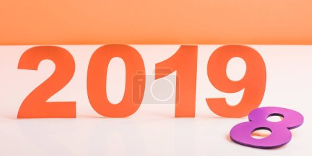 Photo for Coral paper cut 2019 numbers and violet number 8 on white surface, color of 2019 concept - Royalty Free Image