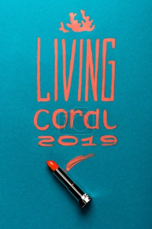 Photo for Color of year 2019 handwritten lettering with coral lipstick on blue background - Royalty Free Image