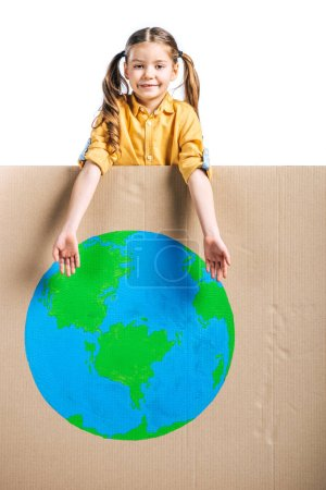 Photo for Cute smiling child pointing at globe sign on cardboard placard isolated on white, earth day concept - Royalty Free Image