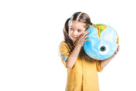 Photo pour Mignon enfant tenant globe près oreille isolé sur blanc, notion de jour de la terre - image libre de droit