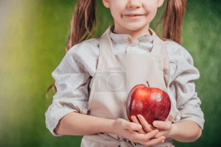 Photo for Cropped view of child holding apple on blurred background, earth day concept - Royalty Free Image