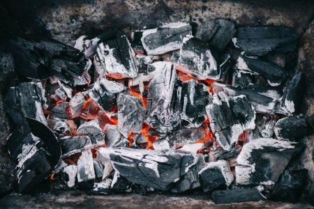Foto de Top view of hot burning coals with ash in fireplace - Imagen libre de derechos
