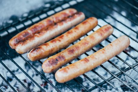 Photo for Selective focus of tasty grilled sausages on bbq grill grade - Royalty Free Image