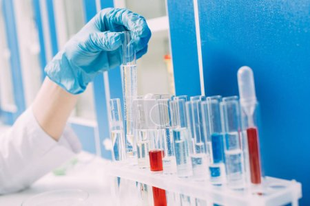 Photo for Cropped view of female scientist picking test tube in laboratory - Royalty Free Image