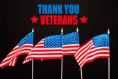 american flags with thank you veterans lettering isolated on black