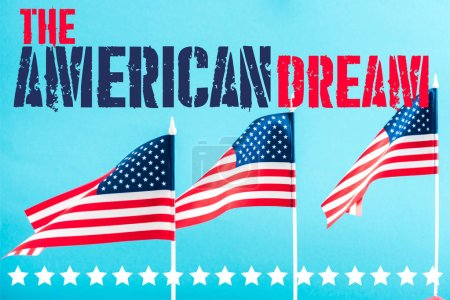 Photo for American flags with the american dream lettering and stars on blue - Royalty Free Image