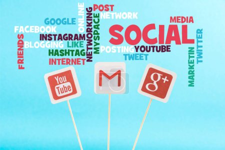 Photo for Social media words and cards with youtube, gmail and google plus logo isolated on blue - Royalty Free Image
