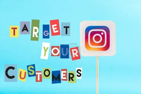 Photo for Card with instagram logo and target your customers lettering isolated on blue - Royalty Free Image
