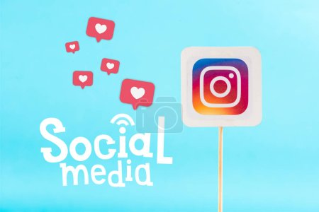 Photo for Card with instagram logo and social media lettering with heart icons isolated on blue - Royalty Free Image