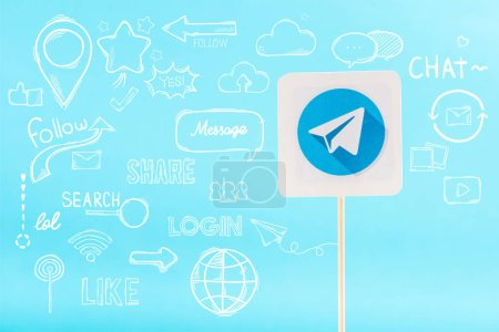 Photo for Card with telegram logo and social media icons isolated on blue - Royalty Free Image