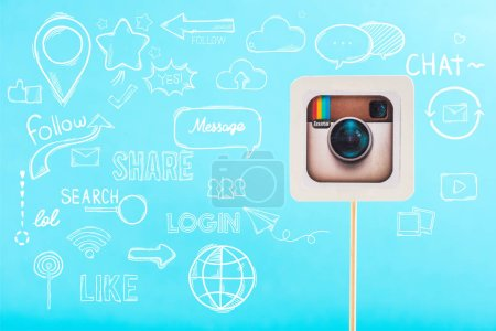 card with instagram logo and social media illustration isolated on blue