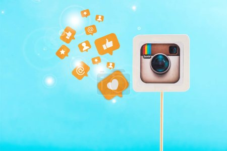 card with instagram logo and social media icons and sparkles on blue