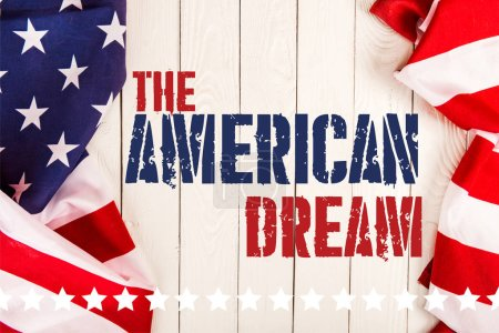 Photo for Top view of american flags and the american dream lettering on white wooden surface - Royalty Free Image
