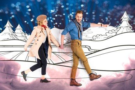 Foto de Elegant couple holding hands and walking together with nature illustration, sparkles and smoke on background - Imagen libre de derechos