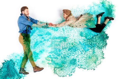 Foto de Elegant woman levitating in air and holding hands with man on background with watercolor turquoise spills - Imagen libre de derechos