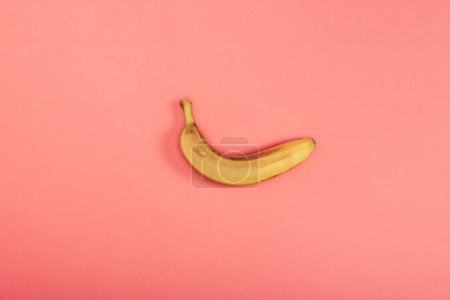 Photo for Top view of fresh bright and yellow banana on coral background - Royalty Free Image