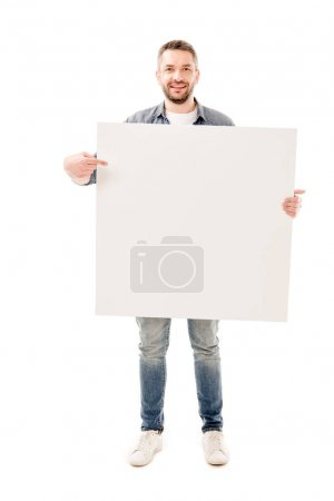 Photo for Full length view of smiling bearded man holding blank placard isolated on white - Royalty Free Image