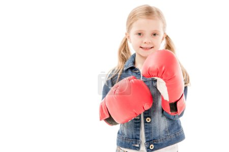 Photo for Front view of smiling kid in red boxing gloves isolated on white - Royalty Free Image