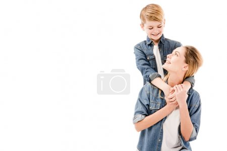 Photo for Happy mother and son embracing isolated on white - Royalty Free Image