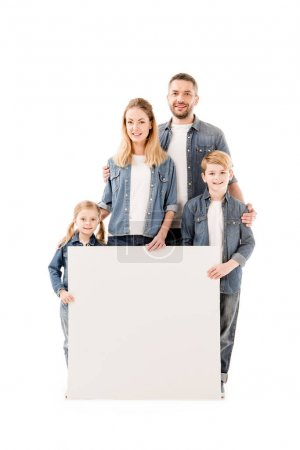 Photo for Full length view of happy family smiling and holding blank placard isolated on white - Royalty Free Image