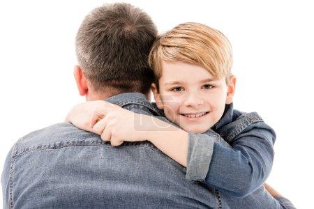 Photo pour Excité sourire garçon embrassant père isolé sur blanc - image libre de droit