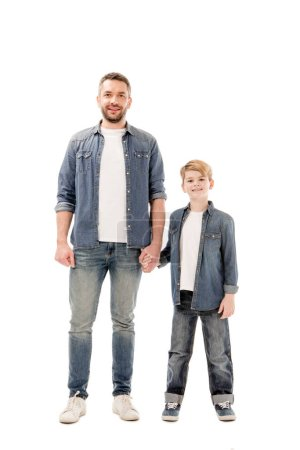 full length view of smiling son and father holding hands isolated on white