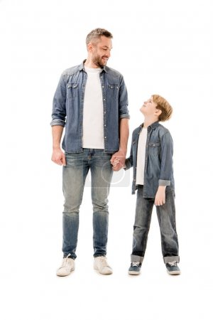 Photo for Full length view of smiling son and father holding hands isolated on white - Royalty Free Image