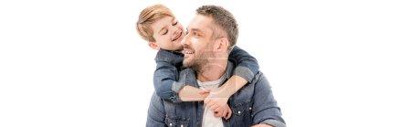 Photo pour Plan panoramique de garçon souriant embrassant père isolé sur blanc - image libre de droit