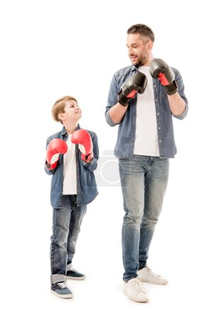 Photo for Full length view of father and son in boxing gloves isolated on white - Royalty Free Image