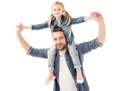 Photo for Smiling father holding daughter on shoulders isolated on white - Royalty Free Image