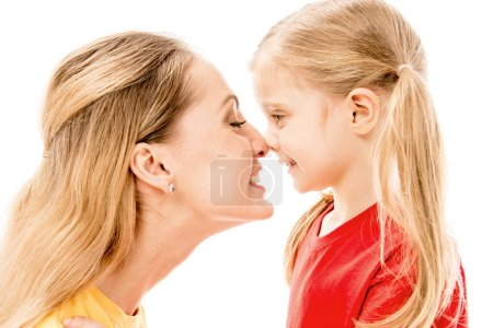 Photo for Side view of happy mother and daughter touching noses isolated on white - Royalty Free Image