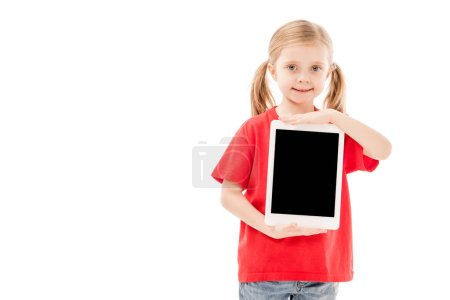 smiling child in red t-shirt holding digital tablet with blank screen isolated on white