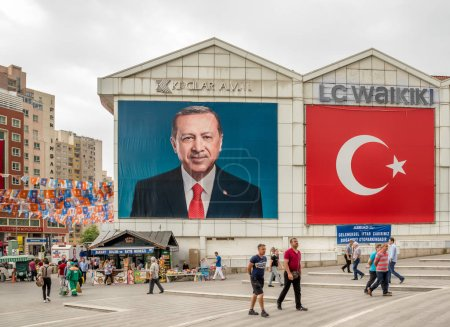 Poster of Turkish Prime Minister Recep Tayyip Erdogan and Turkish flag on a building in Bursa,Turkey.20 May 201