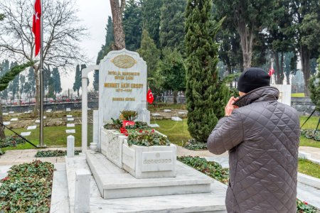 Unidentified man prays at Tomb of Mehmet Akif Ersoy,poet and author of Turkish National Anthem at Edirnekapi Martyr's Cemetery in Eyup district of Istanbul Province, Turkey.22 January 2017
