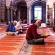 Unidentified Turkish Muslim men reading koran in Suleymaniye mosque,decorated with Islamic elements and designed by Ottoman architect Sinan.Istanbul,Turkey.04 June 2017