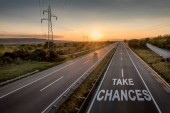 Beautiful Countryside Motorway with a Single Car at sunset with motivational message Take Chances