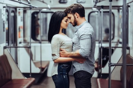 Photo for Young romantic couple in subway. Underground love story. - Royalty Free Image