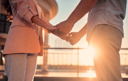 Photo for Love is in the air! Cute romantic couple spending time together in the city. Handsome bearded man and attractive young woman are in love. Hugging, kissing and having fun during the sunset. - Royalty Free Image