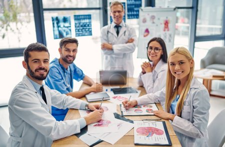 Photo for Group of doctors working together in clinic. Medical personnel in uniform. - Royalty Free Image