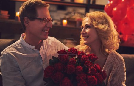 Photo for Love has no age! Romantic senior couple celebrating Saint Valentine's Day at home. Beautiful woman and handsome man enjoying spending time together. Happy Saint Valentine's Day! - Royalty Free Image
