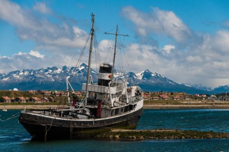 Photo for The El remolcador Christofer is an old tug boat stranded near Ushuaias harbour - Royalty Free Image
