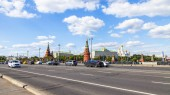 Moscow, Russia, on June 25, 2018. Cars go on Big Stone Bridge. Towers of the Moscow Kremlin are visible in the distance
