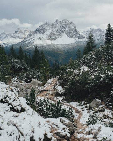 Scenic panoramic view of Dolomites mountains under white snow