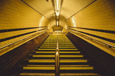 Photo for Yellow tunnel and staircase on London city underground - Royalty Free Image