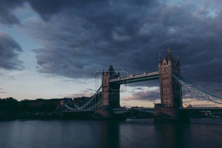 Scenic view of Tower Bridge on London city skyline at cloudy sunset