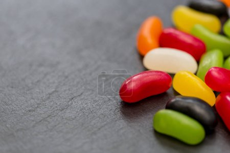 Jelly beans candy sweets on dark background