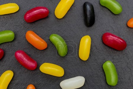 Jelly beans candy sweets abstract food dark background