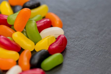 Jelly beans candy sweets on dark background with copy space