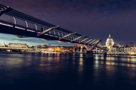 Modern London city skyline St Pauls Cathedral and Bridge on River Thames at night